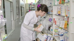 Stock Video Footage of Pharmacist assistant working at russian pharmacy drugstore unloading deliveries