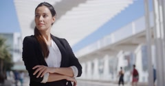 Thoughtful businesswoman with folded arms - stock footage