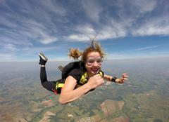 Skydiving pretty woman Stock Photos