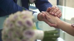 Bride stroking hands of the bride Stock Footage