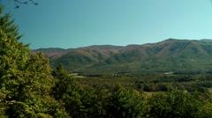 Red autumn mountain ridges valley Stock Footage