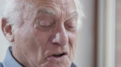 4K Close up portrait of elderly man laughing Stock Footage
