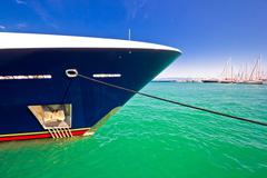Luxury yacht prow view on colorful sea - stock photo