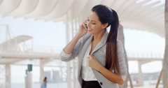 Woman using a mobile in a high key environment Stock Footage