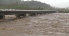 Raging River Flood Water As Hurricane Hits With Torrential Rain wide shot Stock Footage