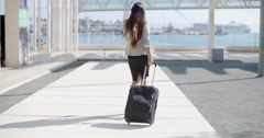 Woman traveler in an urban street - stock footage