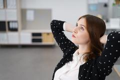 Pensive Young Office Woman Looking Up - stock photo