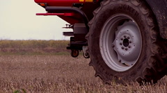 Fertilizer spreading on the field close up shot  - stock footage