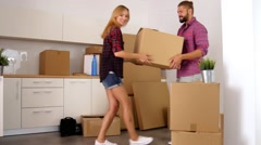 Young couple just move to their new apartment. They are still unpacked. Stock Footage
