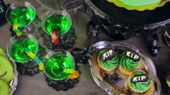 Food table arrangement prepared for Halloween party. Stock Footage