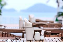 Dining table on sea and moutain background in sunshine - stock photo
