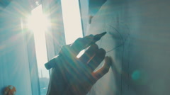 Girl draws on the easel in the rays of the setting sun Stock Footage