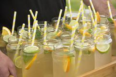 Lemonade in mason jars with drinking straws Stock Photos