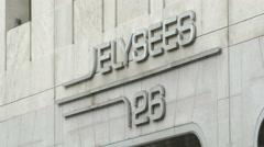 Galerie Marchande 26 logo on Avenue des Champs-Elysees, Paris Stock Footage