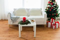 Stock Photo of sofa, table and christmas tree with gifts at home
