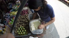 Woman packing tofu bean curd in tin can Stock Footage