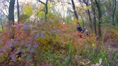 Group of happy children in a city park with a teacher exploring nature. - stock footage