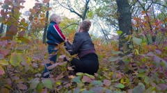 Stock Video Footage of Beautiful mother with her young son in the autumn park view nature.