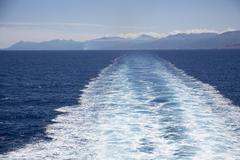 Wake in sea against sky Stock Photos