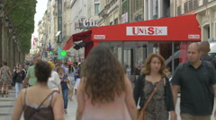 Passing by Le Madrigal restaurant on Avenue des Champs-Elysees in Paris Stock Footage