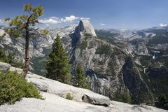 View from Glacier Point to Half Dome Vernal Fall and Nevada at the rear right - stock photo
