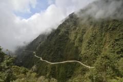 Death Road meanders through subtropical rainforest Camino de la Muerte North - stock photo