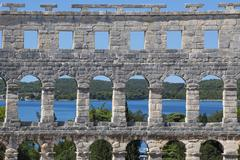 Roman amphitheater with arches Adriatic Sea behind Pula Istria Croatia Europe Stock Photos