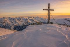 Rastkogel summit cross 2762m winter view of Hintertux Glacier and Olperer Tux Stock Photos