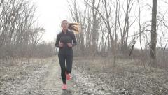 Woman running in autumn winter cardio exercise - stock footage