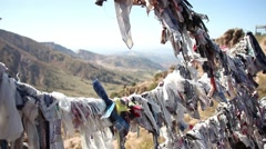 Laundry rags on line in Chatkal Mountains valley in Chimgan, Uzbekistan Stock Footage