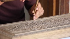 Woodcarving, man carves the original ornament on a wooden board Stock Footage