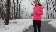 Winter cardio exercise - woman jogging running Stock Footage
