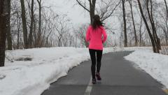 Runner running in winter snow - active lifestyle Arkistovideo