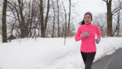 Winter jogging - woman runner running in cold air Stock Footage