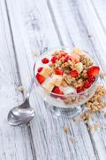 Glass with Crunchy Yoghurt and fresh fruits - stock photo