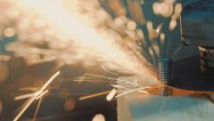 A worker cuts the bolt grinder Stock Footage