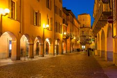 Old town of Alba in evening. - stock photo