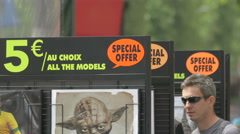 Posters on a street stall on Champs-Elysees boulevard, Paris Stock Footage
