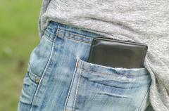 Stock Photo of Black wallet in the back pocket