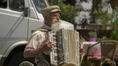 Elderly man playing accordion in Warsaw - stock footage
