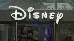 Disney logo on Avenue des Champs-Elysees, Paris Stock Footage