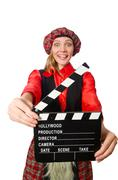 Stock Photo of Funny woman in scottish clothing with movie board
