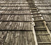 Old wooden staircase on wooden roof.Useful as background Stock Photos