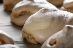 Baked white meringues Stock Photos