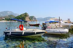 Pleasure boats at the waterfront in resort town of Petrovac, Montenegro Stock Photos