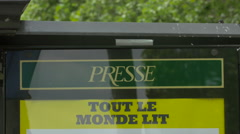Street display board on Champs-Elysees boulevard, Paris Stock Footage