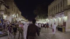 Large shot walking in old market Stock Footage