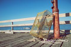 Lobster traps at a fishing pier in New England - stock photo
