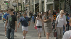 Walking by United Colors of Benetton on Avenue des Champs-Elysees, Paris Stock Footage