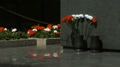 Red and white carnations next to a marble pedestal in Warsaw Stock Footage